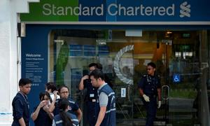 Court rules Britain free to extradite Singapore bank robbery suspect