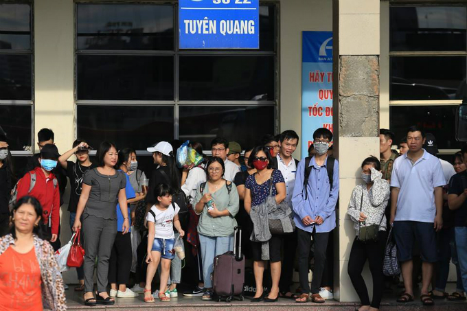 At the My Dinh bus station in Hanoi, many passengers had to wait for hours to get a bus to go home. The station added an extra 140 buses to meet the increased demand.