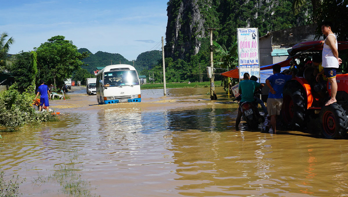 Many vehicles struggle to squeeze through the flooded areas to get to the districts town.