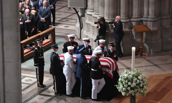 Two presidents honor McCain at funeral as Trump heads to golf club