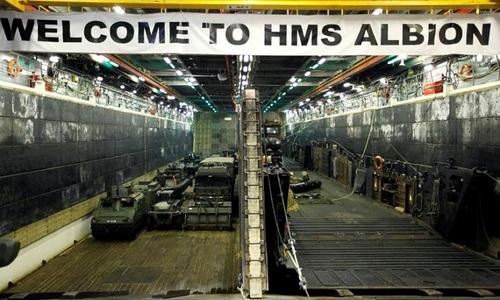 British Navy warship sails near Beijing-claimed islands: sources