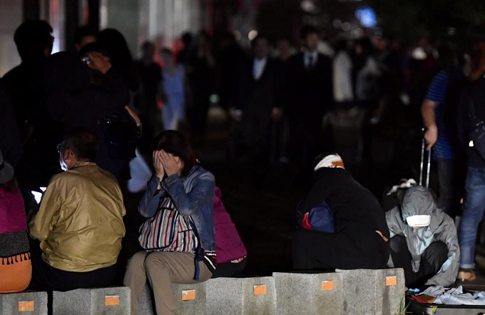 People react during blackout after a powerful earthquake hit the area in Sapporo, Japan in this photo taken by Kyodo September 6, 2018. Mandatory credit Kyodo/via Reuters