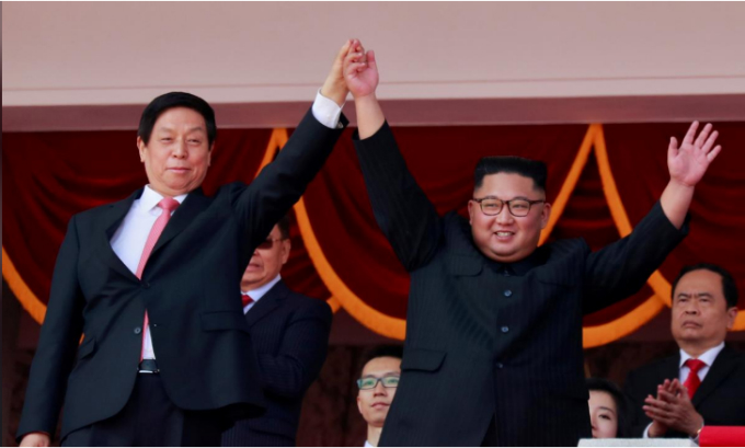 North Korean leader Kim Jong Un and Chinas Li Zhanshu, chairman of the Standing Committee of the National Peoples Congress (NPC), wave to people while attending a military parade marking the 70th anniversary of North Koreas foundation in Pyongyang, North Korea, September 9, 2018. Photo by REUTERS/Danish Siddiqui