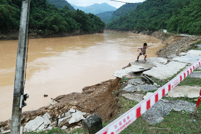 This boy plays on what used to be the front yard of his home. Vi Dinh Phuc, the communes chairman, said 31 houses in the commune have been completely washed away or seriously damaged and the floods also isolated the entire commune for five days.