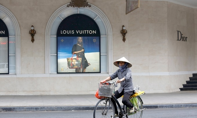Two firms lord it over Vietnam high-fashion scene