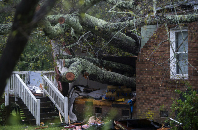 A tree that fell on this house during Hurricane Florence killed a woman and her baby