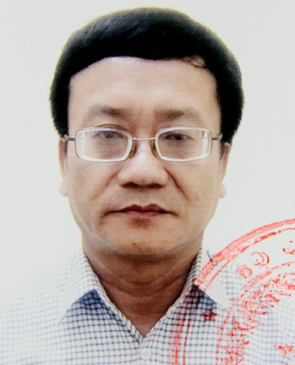 Nguyen Quang Vinh, Hoa Binhs chief testing official, is seen in a police photo.