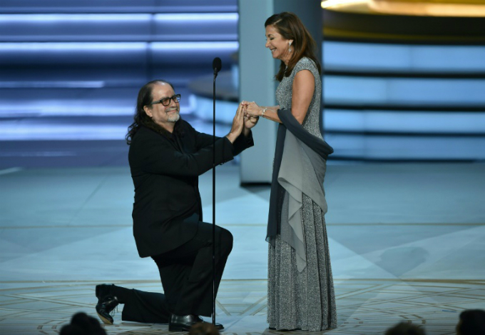 Glenn Weiss (L), winner of the Emmy for best directing of a variety special for The Oscars, proposes to Jan Svendsen onstage during the ceremony. Photo by AFP/Robyn Beck
