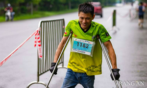 A Vietnamese man on crutches scales peak after peak