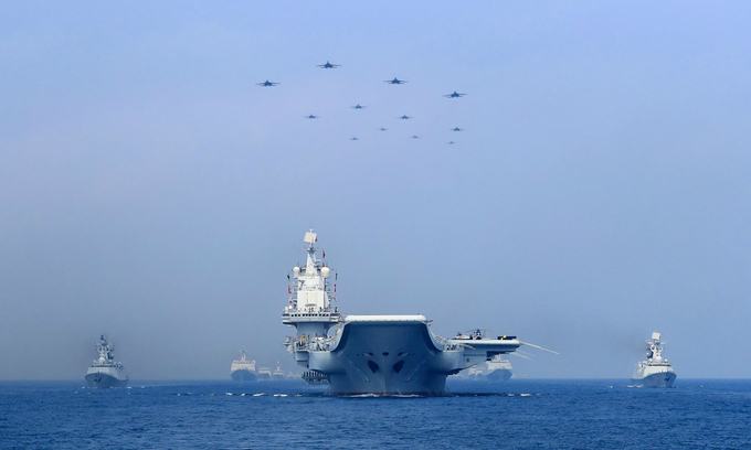 Warships and fighter jets of Chinese Peoples Liberation Army Navy take part in a military display in the South China Sea, April 12, 2018. Photo by Reuters/Stringer