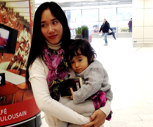 Nguyen Thi Thanh Huyen holds her daughter in France after a 15-month separation as her French partner left HCMC with the girl. Photo acquired by VnExpress