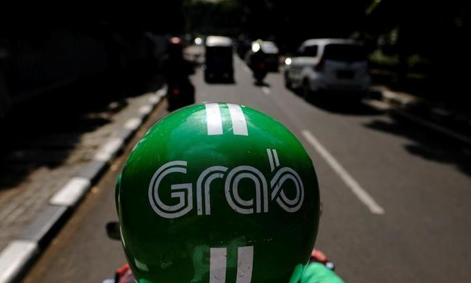 Experts fear foreign rivals too strong for Vietnam ride-hailing firms