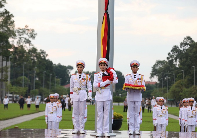 Soldiers perform a flag ritual to start two-day state mourning for President Tran Dai Quang in Hanoi.