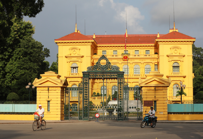The national flag is flown at half mast at the Presidential Palace in Ba Dinh District, Hanoi, on Wednesday morning.