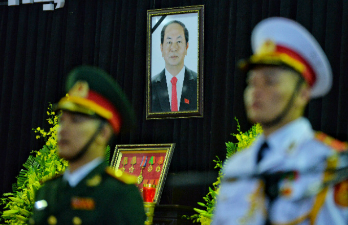 President Quangs portrait and medals are shown at the funeral. He served in many high-ranking positions and was Minister of Public Security before becoming president in April 2016.