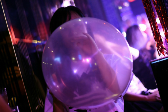 Ultra-popular funky balloons filled with laughing gas offer a legal route to a quick high. Photo by AFP/Manan VATSYAYANA