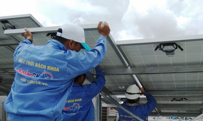 The workers support customer with the BigK solar solution.