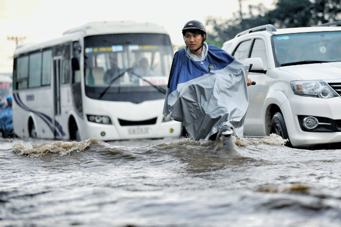 Kindness shines through the chaos as Saigon grapples with flooded streets