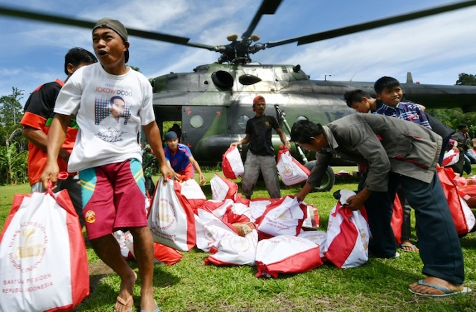 Indonesian army choppers are running missions to deliver supplies to remote parts of the region. Photo by AFP