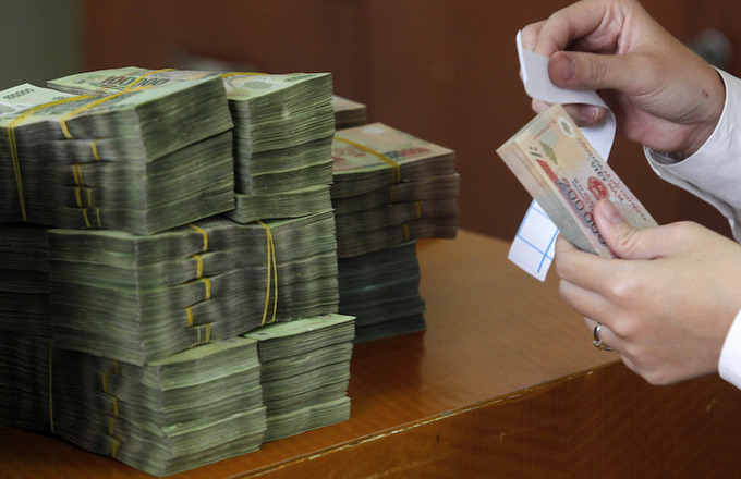 Vietnam's exchange rate won't go haywire this year: experts