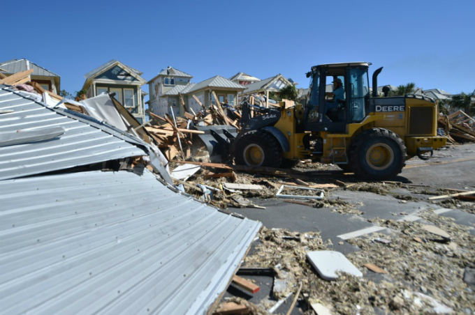 A bulldozer clears up debris in Mexico Beach, Florida, following Hurricane Michael