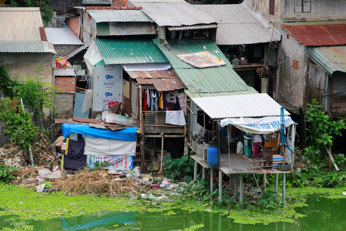 15,000 people live an imperial life in Hue slum - 1