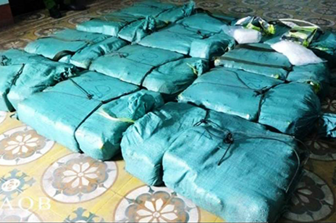 Police find more than 300 kilograms of meth inside 12 bags. Photo by Ngo Quang Van