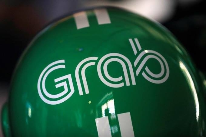 Taxi or not? Vietnam debate rages over Grab status