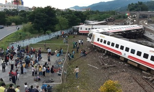 18 dead after train flips in Taiwan
