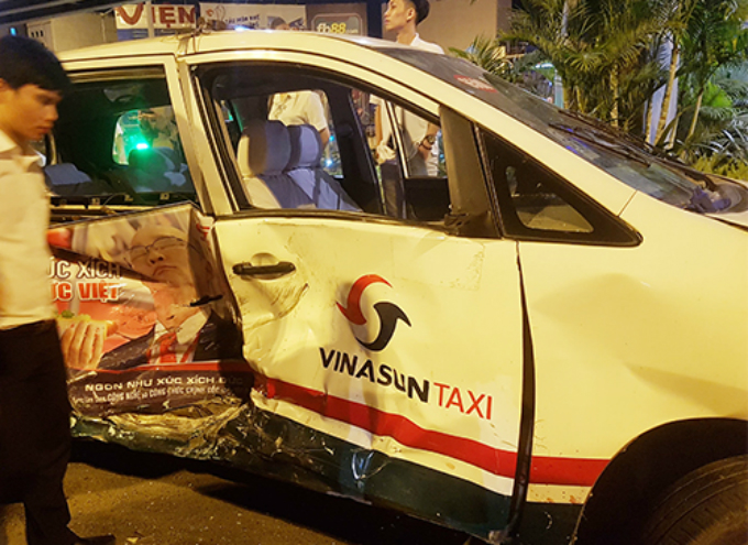 A taxis is knocked down and serious damaged. Photo by Son Hoa