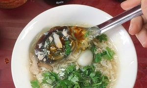 Super supper: crab soup kitchens provide warmth on rainy Saigon days
