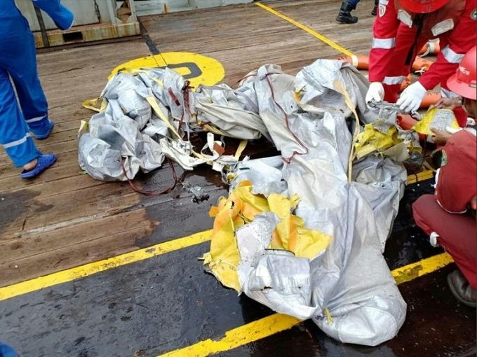 Debris apparently from the crashed jet was pulled out of the water. Photo by AFP