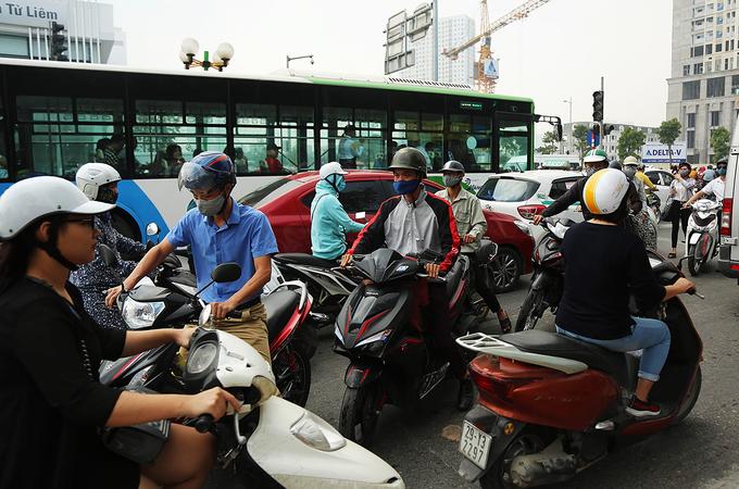 Near downtown Hanoi, residents take their bikes for a walk - 4