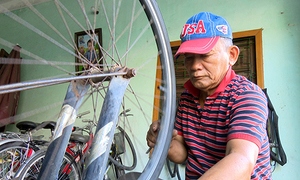 At 70, bicycle mechanic becomes stickler for rules
