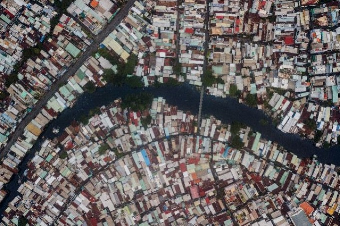 Ho Chi Minh City boasts large sprawling communities living along polluted waterways. Photo by AFP/Kao Nguyen