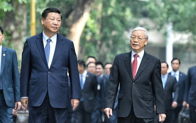 Chinas President Xi Xinping (L) and Vietnams Party Secretary Nguyen Phu Trong walk in Hanoi during Xis visit to Vietnam in November 2017. Photo by VnExpress/Giang Huy