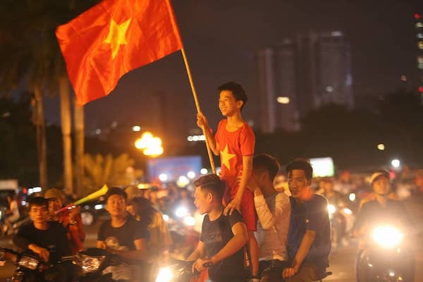 Fans light up the night after Vietnams victory against Malaysia