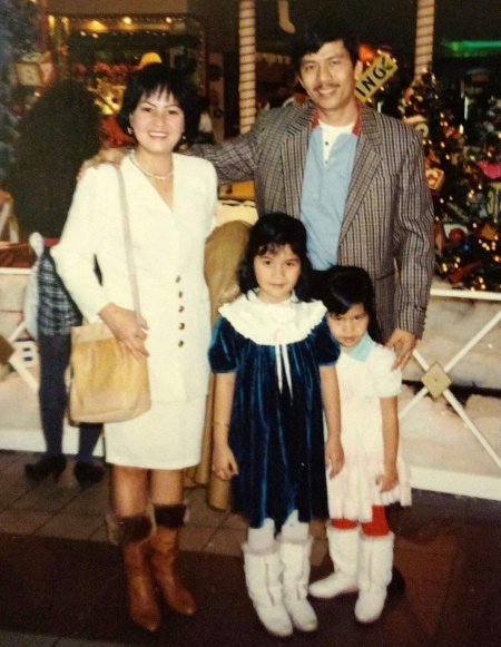 Tram Nguyen, in front with her younger sister and parents in a party in December, 1992, their first year in the US. Photo: Tram Nguyen.