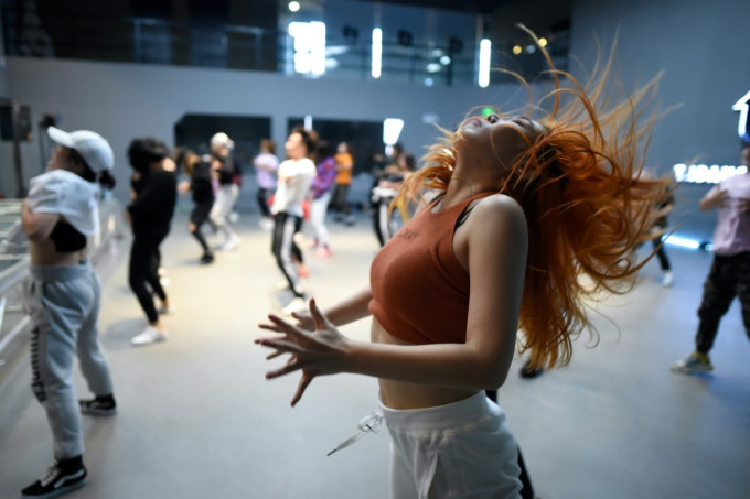 Many dancers see the style as a hip form of exercise or even an alternative way of living. Photo by AFP/Wang Zhao