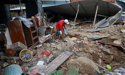 Rains, floods, tears: weekend landslides shatter lives in central Vietnam