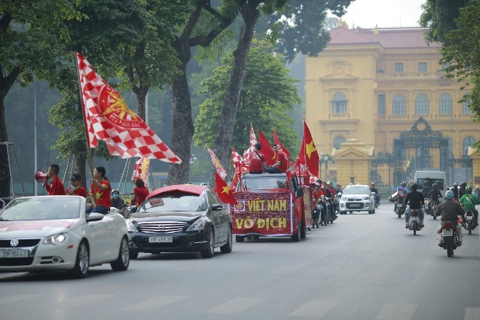 Football fans parade as Vietnam meet Cambodia on home ground