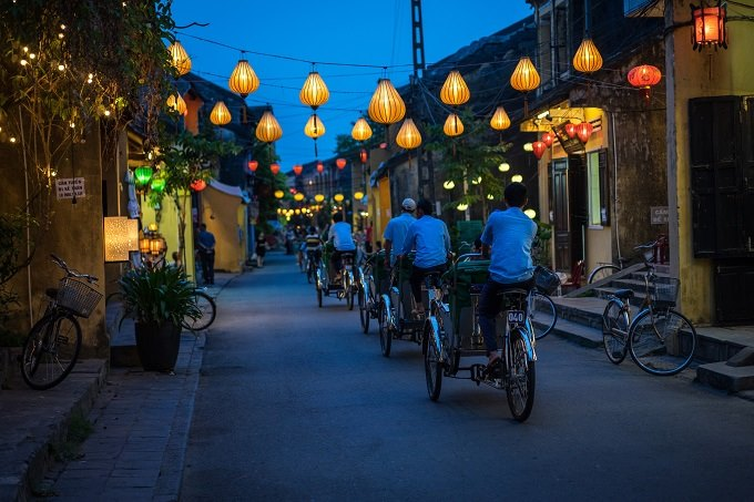 A street in Hoi An at night. Photo by Shutterstock/1tomm