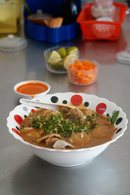 The price of a bowl of satay venison noodle soup is VND65,000 ($2.8).