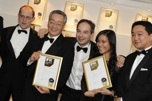 Trang and her colleagues with awards they received from the International Financial Review (IFR). Photo courtesy of IFR.