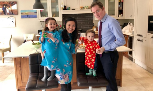 Trang Nguyen with her husband and two children in Lunar New Year costumes last year. Photo courtesy of Trang Nguyen.