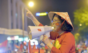 Hanoi awash in red again as football fans go into a frenzy