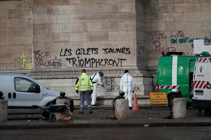 Cleanup operations continue under the message, The Yellow Vests will Triumph written on the Arc de Triomphe, the morning after clashes with protesters wearing yellow vests, a symbol of a French driversu0027 protest against higher diesel taxes, in Paris, France, December 2, 2018. Photo by Reuters