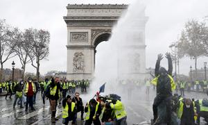 'Yellow vest' protesters knock wind out of French business, economy