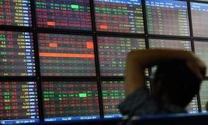 SE Asia Stocks fall on flattening US yield curve, trade worries