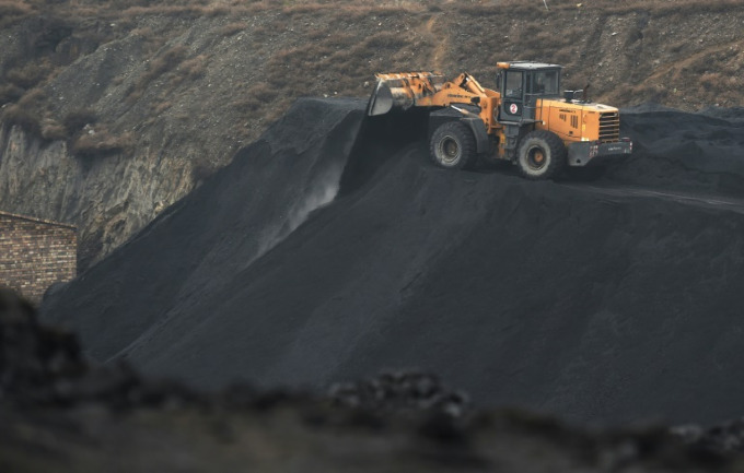 Globally, coal use accounts for 40 percent of CO2 emissions, and is on the rise. Photo by AFP/GREG BAKER